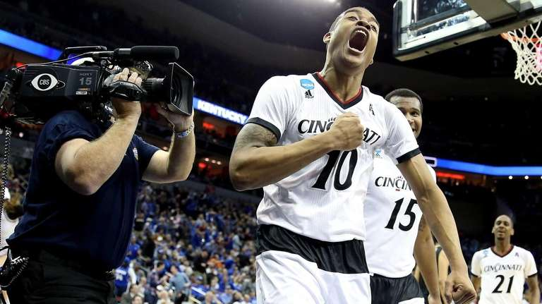 Troy Caupain of the Cincinnati Bearcats reacts against
