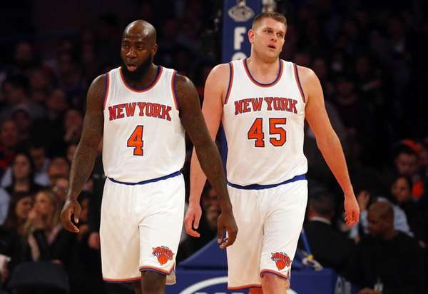 Quincy Acy and Cole Aldrich of the New