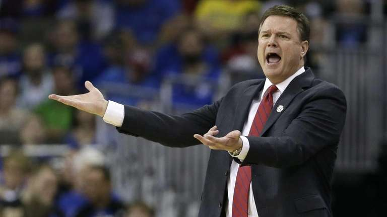 Kansas head coach Bill Self reacts to a