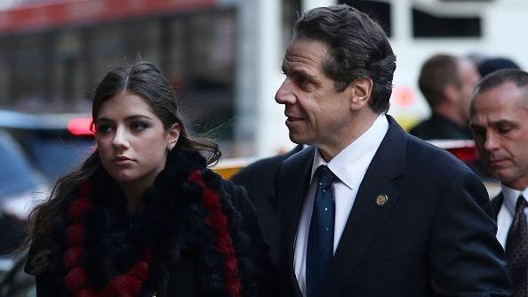 New York Gov. Andrew Cuomo walks into a