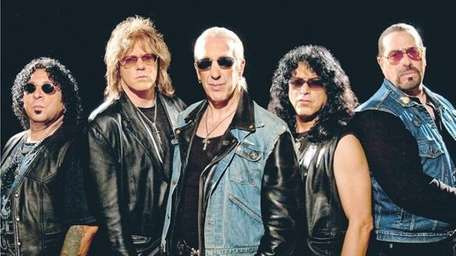 A.J. Pero, left, with his Twisted Sister band