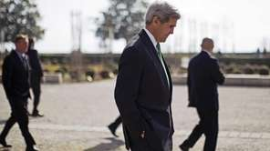 Secretary of State John Kerry walks around the