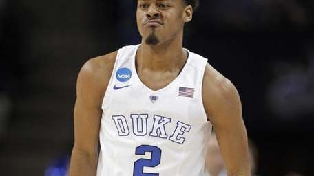 Duke's Quinn Cook reacts after a basket against