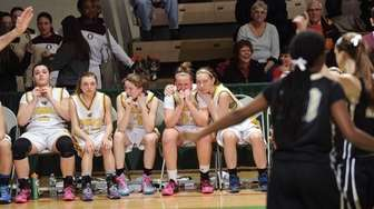 Commack players react to a loss to Rush-Henrietta
