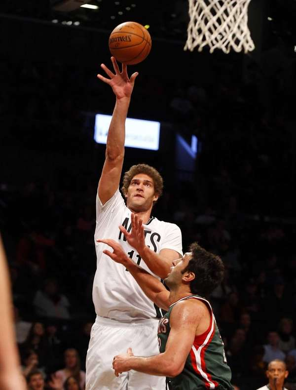 Brook Lopez of the Brooklyn Nets puts up