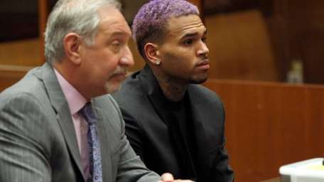 Singer Chris Brown, right, and his lawyer Mark