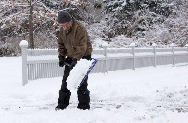 Albert Carlson clears his driveway in Setauket of