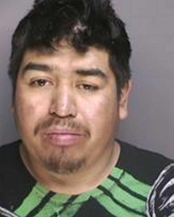 Jesus Flores, 25, of Riverhead, was arrested on