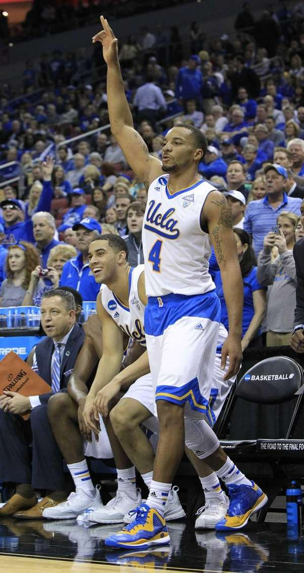UCLA guard Norman Powell celebrates as the clock