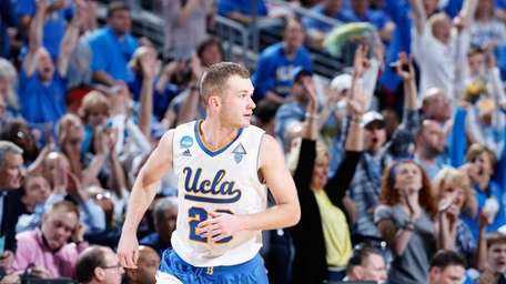 Bryce Alford of UCLA runs down the court