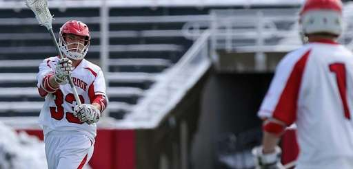 Stony Brook midfielder Matt Robison passes the ball