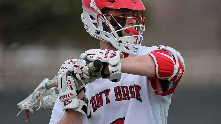 Stony Brook midfielder Mike Rooney looks to pass
