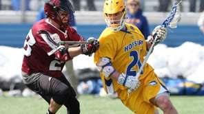 Hofstra's Korey Hendrickson carries the ball while being