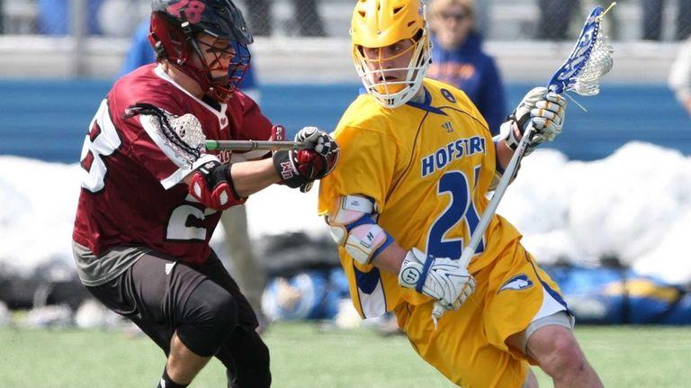 Hofstra's Korey Hendrickson carries the ball while being