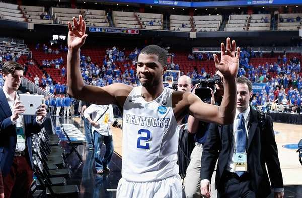 Aaron Harrison of the Kentucky Wildcats walks off