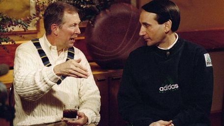 Then-Michigan coach Steve Fisher, left, and Duke coach