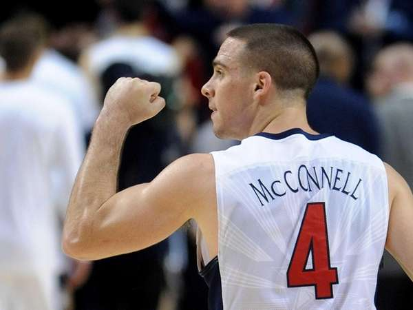 Arizona guard T.J. McConnell pumps his fist to