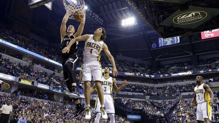 Brooklyn Nets center Mason Plumlee gets a dunk