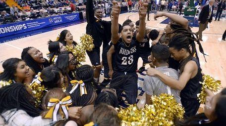 Bridgehampton's Elijah Jackson, center, celebrates with teammates and