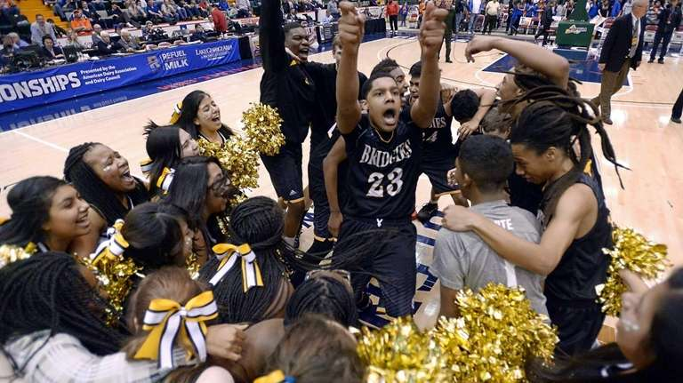 Bridgehampton's Elijah Jackson, center, celebrates with teammates and