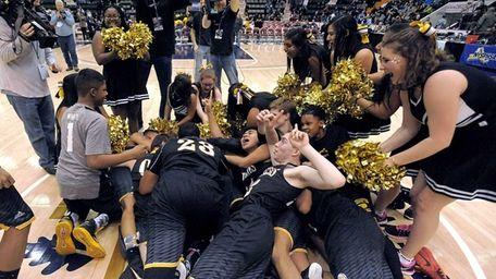 Bridgehampton players and cheerleaders celebrate their win in