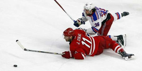 Carolina Hurricanes' Jordan Staal collides with New York