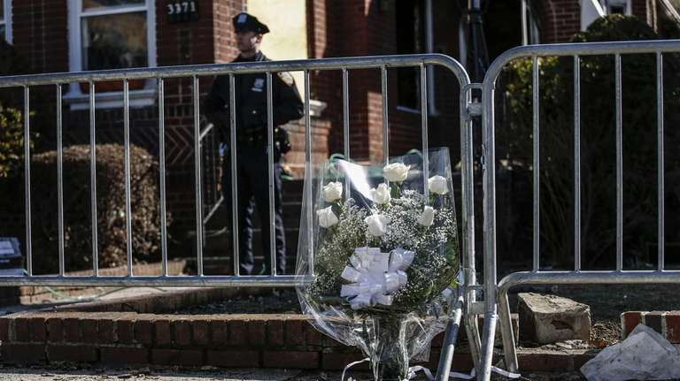 A flower arrangement rests at the scene of