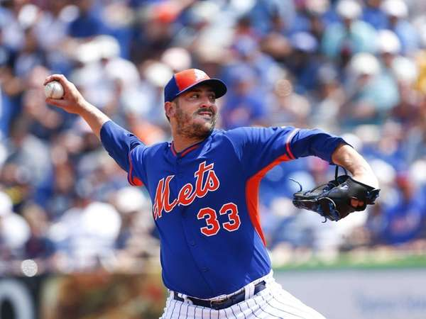 Mets starting pitcher Matt Harvey (33) works in