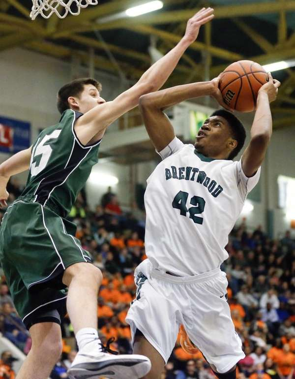 Shenendehowa's Thomas Huerter, left, defends against Brentwood's Jamel