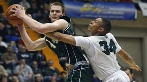 Shenendehowa's Brandon Fisher, left, grabs a rebound in