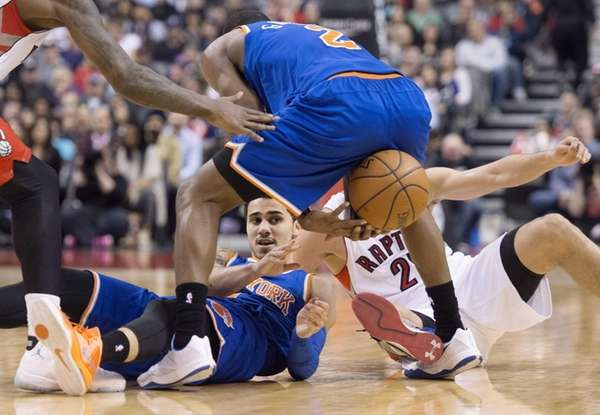 The New York Knicks' Shane Larkin, left, passes