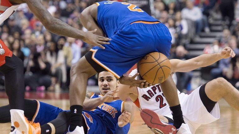 The New York Knicks' Shane Larkin, left, passes