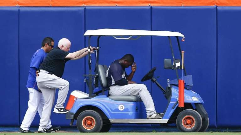 New York Yankees centerfielder Jose Pirela, right, waits