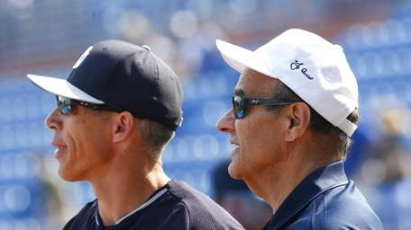 Former New York Yankees manager Joe Torre, right,