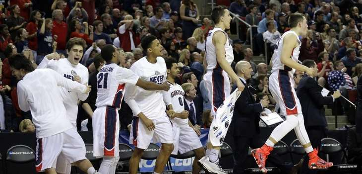 Players on the Gonzaga bench react to a