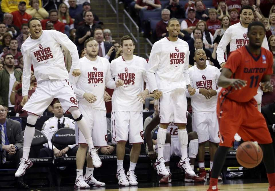The Oklahoma bench reacts in the second half