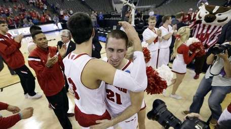 Wisconsin guard Josh Gasser (21) celebrates with teammate