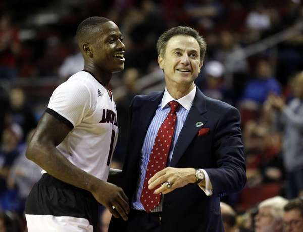 Louisville head coach Rick Pitino hugs guard Terry