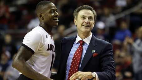 Louisville head coach Rick Pitino hugs guard Terry