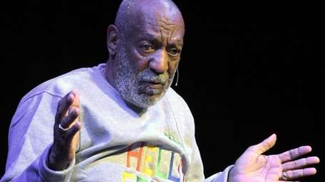 Comedian Bill Cosby performs during a show at