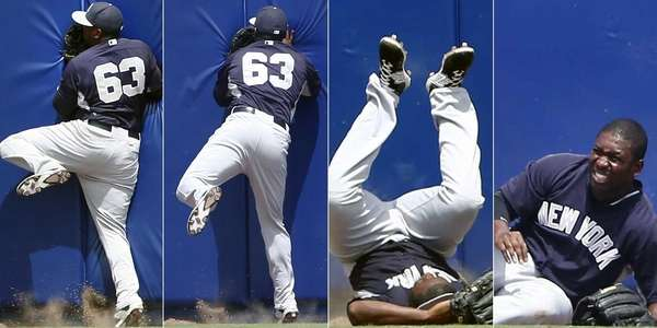 Yankees centerfielder Jose Pirela crashes into the wall