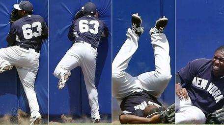 Yankees centerfielder Jose Pirela crashes into the wall