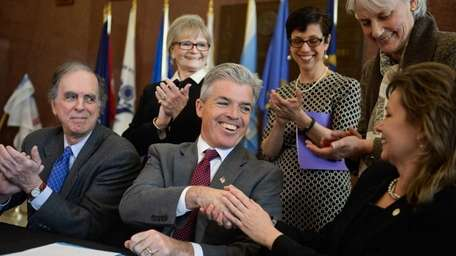 Suffolk County Executive Steve Bellone, shakes hands with