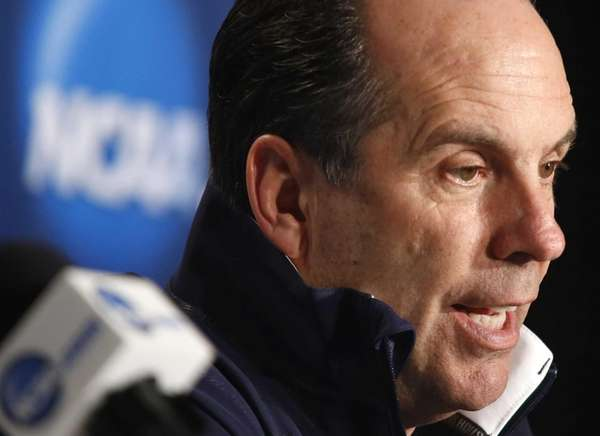 Notre Dame head coach Mike Brey answers a