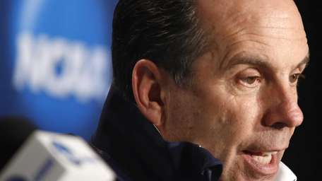 Notre Dame head coach Mike Brey answers a