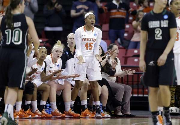 Princeton forward Leslie Robinson reacts to an official's