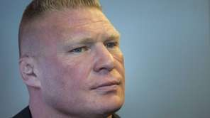 Former UFC heavyweight champion Brock Lesnar pauses for