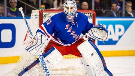 New York Rangers goalie Cam Talbot tends to