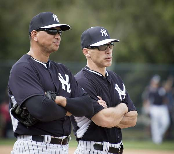 Yankees third baseman Alex Rodriguez talks with manager