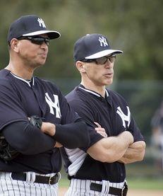 Yankees third baseman Alex Rodriguez talks with manager